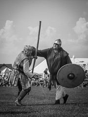 [2009-06-28@15.47.29a] (Untempered Photography) Tags: monochrome fight helmet battle medieval sword shield armour vignette reenactment skirmish combatant platearmour chatteris gambeson untemperedeye untemperedeyephotography chatterismedievalfestival2009