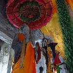 "Buddha Statue with Umbrella <a style=""margin-left:10px; font-size:0.8em;"" href=""http://www.flickr.com/photos/14315427@N00/6968862246/"" target=""_blank"">@flickr</a>"