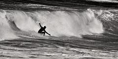 Strike a pose! (Alistair Hamill) Tags: ocean ireland white black mono waves surfer atlantic breakers northern portrush blackwhitephotos
