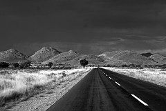 Storm Coming! (Joshua Zakary) Tags: poverty africa road blackandwhite storm mountains clouds truck shadows village poor namibia