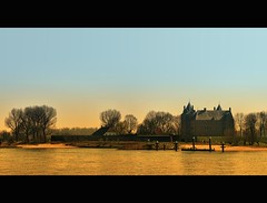 Loevestein (Wim K) Tags: sky holland color reflection castle water netherlands dutch river flow photography gold photo political stock nederland delta surface prison rhine rijn stockphoto waal prisoners stockphotography estuarium wpk wpk2