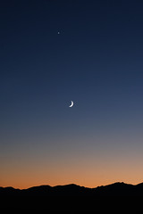 Desert Night (ScooteRoo) Tags: desert night skyline sunset mountainrange moon planet star gradient blue orange silhouette minimalism highway travel vacation challengefactory thechallengefactory fotocompetitionbronze 3waychallenge motifd tcf sky outdoor