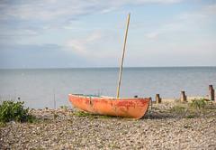 Whitstable (eddiebotsio) Tags: sunset sea beach water landscape boat couple pebbles hut gymnast shore hull upturned dogacrobat
