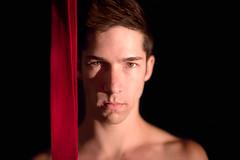 Scarlet Straps (Mario Segovia) Tags: red circus portraiture cirque straps segography