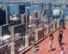 Top of the Rock Observation Deck at Rockefeller Center, New York City (jag9889) Tags: nyc newyorkcity people woman usa ny newyork water glass river observation unitedstates panel outdoor manhattan unitedstatesofamerica rockefellercenter aerialview tourist midtown deck observatory hudsonriver topoftherock waterway rockefellerplaza 2016 jag9889 20160614