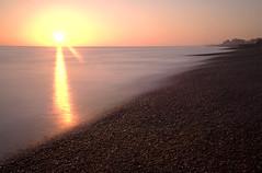 Brighton (- Alex Witt -) Tags: winter light sunset sea bw sun motion blur english beach water beautiful 30 speed evening coast nikon brighton long exposure glow slow 10 south extreme smooth stop nd shutter channel density neutral filer 28200mm d700