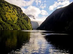 Reflections of a Sound (Timothy Hunter) Tags: newzealand mountains reflection nature water clouds contrast landscape scenery samsung nz lordoftherings fiord doubtfulsound middleearth fiordlands
