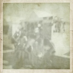 fading from memory (friendlydrag0n) Tags: camera old holiday blur texture film monochrome loss vintage sadness mono photo seaside blurry shot box album snapshot border blurred snap faded memory damage faux fading melancholy distress faulty