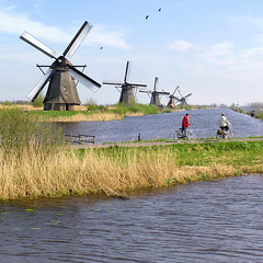The famous Windmills of Kinderdijk (Bn) Tags: world dykes sky holland green heritage classic mill water netherlands windmill dutch grass bike bicycle landscape geotagged geese spring topf50 day quality famous sails nederland bikes windmills best goose ganzen unesco clear historical nl mills viewpoint wereld lente topf100 paysbas riet topf200 blades kinderdijk fietsen alblasserwaard molen springtime lek fiets drainage pumping molens zuidholland ridderkerk groundwater vanes erfgoed 100faves windpumps 50faves 200faves molenkade overwaard nederwaard energyofwind geo:lon=4644154 geo:lat=51879508
