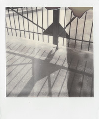 (daveknapik) Tags: shadow blackandwhite film lines triangles fence polaroid newjersey triangle jerseycity gate shadows gates geometry nj shapes fences 600 instant impossible onestep divots onestepexpress polaroidonestepexpress silvershade impossibleproject theimpossibleproject px600 px600uv