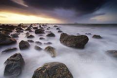 Sun, sea and snow showers... (Stuart Stevenson) Tags: longexposure sunset sun snow seascape water photography evening scotland cool rocks tide stormy showers westcoast northchannel irishsea ailsacraig clydevalley moton coastlife lendalfoot canon1740mm canon5dmkii dumfiresgalloway stuartstevenson ©stuartstevenson paddysmiestone