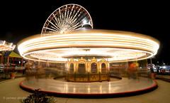 Merry-go-round (startwithz) Tags: longexposure carnival light chicago motion fun pier movement nikon long ride navy trails carousel ferris il tokina ferriswheel navypier lighttrails merry merrygoround starburst sunstar d7000 tokina1116mmf28