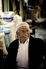 -::::- (|ANA-'3EER|) Tags: old man smile smiling working worker souq  doha qatar      waqif    waqef