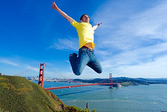 happy young man jumping high in the air (sf-attractions) Tags: goldengate man joy happy jump jumping above flying young energy travel tourist bridge sanfrancisco sky blue day outdoors emotion life lifestyle horizontal view scenic bay landmark clouds city nature yellow casuallydressed jeans caucasian brunette adult one person single spread arms midair energetic accomplishment celebrate celebration copyspace emotional enjoyment expression fitness freedom happiness joyful paradise modelrelease space success triumph triumphant vacation victory yes tshirt air guy california usa sunny attraction destination achievement unitedstatesofamerica