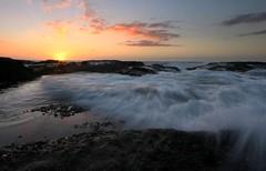 A touch (pominoz) Tags: sea sunrise rocks waves nsw centralcoast frazerparkbeach