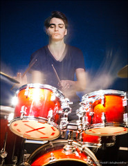 Young drummer in motion playing drums (Dmitry Mordolff) Tags: red party people musician music playing man motion blur male men rock set youth dark studio drums person lights sticks hit concert movement blurry energy exposure artist play hand action percussion stage performance young band jazz pop player equipment entertainment musical drumstick sound instrument beat drummer practice gesture noise performer loud cymbals recording rhythm cymbal drumsticks skill percussionist