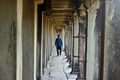 Guarding Coridoor (Balthear) Tags: travel lake silhouette children landscapes cambodia southeastasia khmer monk angkorwat unesco worldheritagesite peoples temples tonlesap basrelief rayoflight siamreap ancientruins streetsphotography canon500d