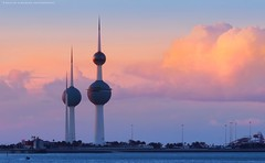 Kuwait towers in sunset (khalid almasoud) Tags: city light sunset sea urban sunlight reflection beach clouds canon buildings golden high flickr all photographer zoom  tow