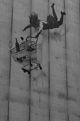 Falling with trolley (jmoran24) Tags: woman art fall graffiti trolley banksy spray falling groceries height