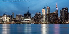 Another Midtown View (DSC06947) (Michael.Lee.Pics.NYC) Tags: newyork reflection architecture night twilight construction nikon sony queens esb eastriver lic empirestatebuilding bluehour longislandcity midtownmanhattan gantryplazastatepark nikkor50mmaf18d a7rm2 americancopperbuildings
