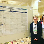 Psychology student and professor pose with student's research.
