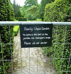 not so useful then (helenoftheways) Tags: signs hedge gate useful gardens hallplace bexley london uk