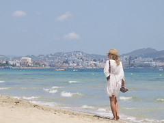woman with shoes in her hands _5169019 (hlh 1960) Tags: woman white beach water beauty hat strand walking shoe sand wasser outdoor urlaub ibiza frau spanien espania kleid weis hoyday