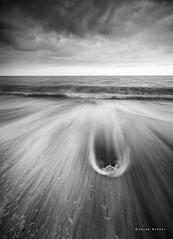 Dragnet (Sarah_Brooks) Tags: summer blackandwhite seascape beach monochrome stone drag mono moody tide wave stormy foam cloudporn swoosh waterscape turnofthetide