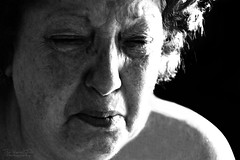 It's a Hard Life (The Vegan Taff Photography) Tags: old portrait people blackandwhite woman monochrome closeup blackbackground pain nikon raw shadows sad candid emo crying monochromatic depression oldlady oldwoman cry emotional emotions grief grieving blackandwhitephotography vulnerable suffer nikond3200 d3200