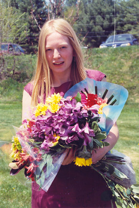 Graduate Ulla Valk Bestowed with Flowers.