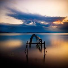 i'll be sittin' when the evenin' come (helen sotiriadis) Tags: wood longexposure blue sunset sea sky orange seascape black water canon landscape twilight dock published greece canonefs1022mmf3545usm aspropyrgos canoneos40d