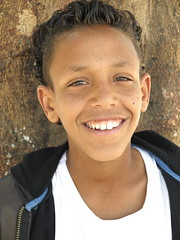 cute Nubian boy (toshu2011) Tags: travel boy cute tourism water smile smiling canon river 1 kid bright g young egypt first x powershot nile g1 damm nil aswan fluss archeology rapid gypten egypte cataract reise egyptology assuan staudamm assouan katarakt aswn stromschnelle lowdam  swenet g1x