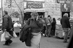 Among Shoppers (Fogel's Focus) Tags: israel fuji 28mm jerusalem stock olympus d76 zuiko f28 2012 20c acros machaneyehuda om1n kodakd76 film:iso=100 legacypro100 developer:brand=kodak developer:name=kodakd76 725min film:brand=freestylearista freestylearistalegacypro film:name=freestylearistalegacypro100 expired72011 filmdev:recipe=7516