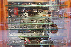 reflection window shop glasses display eyeglasses shelves