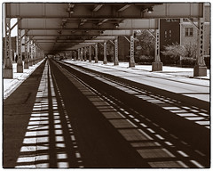World Weary - Duotoned (swanksalot) Tags: shadow blackandwhite bw chicago train photoshop track cta perspective shade duotone toned westloop