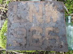 Old Metal Number Plate (The Chairman 8) Tags: 6 glass lines metal stone square moss bottles earth yorkshire w letters border n 9 plate holes number soil numbers round letter l poison registration numberplate stalks queensbury littlemoor nottobetaken lnw966