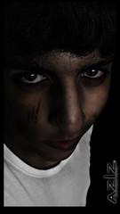 THE BAD DARK - AZIZ (AZIZ Photographer) Tags: boy bw white distortion man black eye strange face cat photoshop dark hair cool eyes sad emo bad young saudi mysterious bandw wound aziz ksa