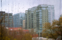 Rainy Cityscape thru the Netting (Orbmiser) Tags: blur rain oregon buildings portland spring nikon cityscape streaks netting d90 55200vr