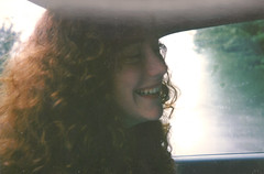 Samantha's Smile (See El Photo) Tags: california ca 15fav favorite hot color colour cute ex girl smile face car smiling cali nose moving colorful colore teeth young longhair cutie redhead gal curly grin inside freckles hottie fav chin goodlooking couleur goodtimes girlfrind samtime