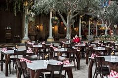 Solitude (Madhusudanan Parthasarathy) Tags: wood red italy food mobile restaurant hotel italian women solitude sitting gulf uae middleeast abudhabi tables lonely charis ferrariworld meditarranena