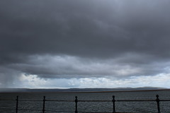 Storm clouds (davidtimms86) Tags: lake water canon eos seagull iii efs1855mm railing cloudysky westkirby thelake f3556 thewirral 1200d