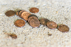 Pennies on a fountain (pillarsoflight) Tags: orange brown black blur fountain beauty oregon 35mm portland prime grey aperture nikon bokeh pavement cent gray adobe copper pdx 18 pnw pennies lightroom onecent d3300