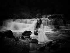 Tell Me Stories (Maren Klemp) Tags: longexposure portrait blackandwhite bw woman selfportrait nature water monochrome fairytale vintage river outdoors rocks stream phone nostalgic melancholy conceptual talking symbolic fineartphotography darkart whitedress fineartphotographer darkartphotography