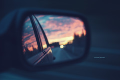 Leaving Behind (jennydasdesign) Tags: road sunset sky car clouds 50mm mirror driving dof sweden bokeh bil sideview 2012 e18 vg solnedgng backspegel sonydslra300 dt50mmf18sam