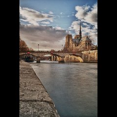 Back of Notre Dame (Zed The Dragon) Tags: city bridge winter light sunset sky bw paris france building seine skyline architecture skyscraper photoshop 35mm reflections pose french landscape geotagged effects photography iso100 photo europe long exposure flickr cityscape minolta photos sony hiver capital f100 notredame full exposition frame nd fullframe alpha reflets quai postproduction hdr highdynamicrange sal zed 2012 francais lightroom historique effets quais storia longue parisien photomatix 24x36 0sec a850 sonyalpha hpexif dslra850 alpha850 zedthedragon mosaique2012a