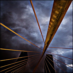 Dark clouds are gathering (Maerten Prins) Tags: bridge sky building lines night clouds dark evening spain skyscrapers footbridge squares bilbao calatrava blocks sortof zubizuri whitebridge puentedelcampovolantin campovolantinbridge