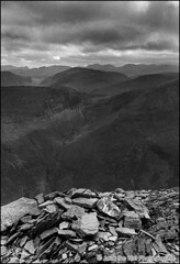 Grisdale Summit (Jack the Hat Photographic) Tags: england bw mountain film stone clouds analog 35mm walking landscape moody lakedistrict stormy hills climbing cumbria fells summit hp5 1998 analogue peaks lakeland ilford cairn jamierobertson grisdale grisdalepike jackthehat