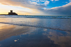 St Ouens (Jonathan.Russell) Tags: camera uk blue sunset sea cloud france reflection tower beach water yellow canon lens islands sand russell dusk jonathan spit jersey kit geography channel rocco backwash whisk 40d