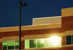 Shiny reflections (Andrea HdG) Tags: windows light sun building brick baltimore lamppost lensflare johnshopkinsbayview