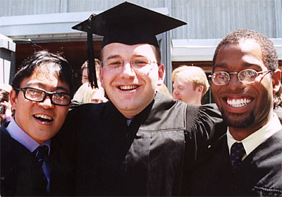 Graduates Michael Rasalan, Koli Shtylla, and Ivan Lenoir Celebrate After the Commencement Ceremony.